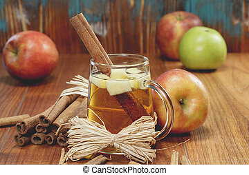 Spiced apple cider - Winter drink with apples and spices on...