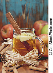Spiced apple cider. - Winter drink with apples and spices on...