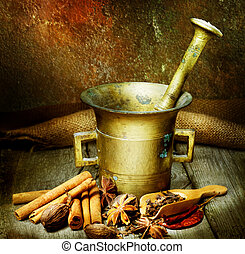 Spices And Antique Mortar With Pestle