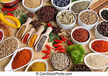 Spices and herbs. - Herbs and spices in ceramic bowls....