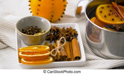 spices and hot mulled wine with orange slices - christmas...