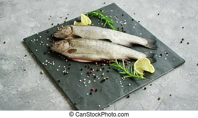 Spices and lemon lying near uncooked fish - Aromatic spices...