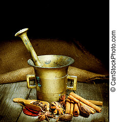 Spices And Mortar Isolated On Black. Vintage Styled