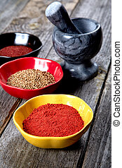 Spices and mortar with pestle on a table