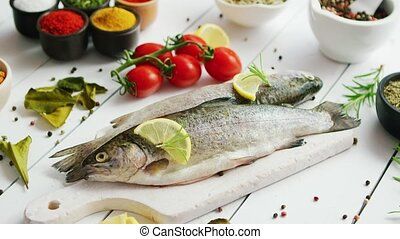 Spices and tomatoes around fish - Various aromatic spices...