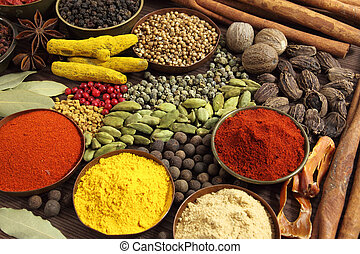 Aromatic spices and herbs in metal bowls. Food and cuisine ingredients.