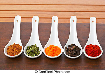 Spices - Assortment of spices in the spoons for prepare ...