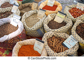 Spices at the market - bags of bulk spices at a market in...