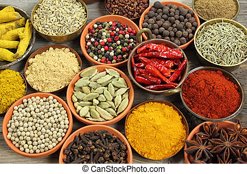 Spices - Colorful spices in ceramic and metal containers - ...