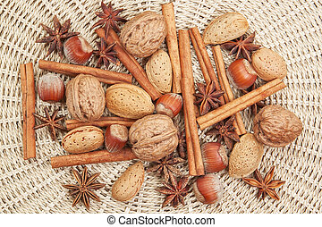 Spices for Christmas of cinnamon, star anise, walnuts, hazelnuts.