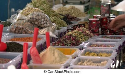 Spices, herbs and nuts at traditional turkish bazaar. Natural seasoning background. Food sale concept.