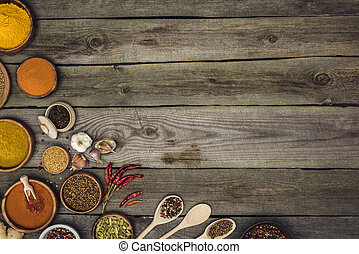 spices in bowls and spoons