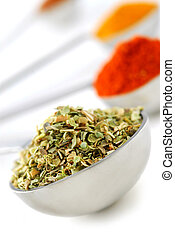 Spices in measuring spoons - Assorted spices in metal...