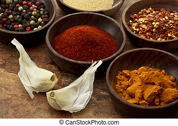 Spices in wooden bowls - Collection of spices in wooden...