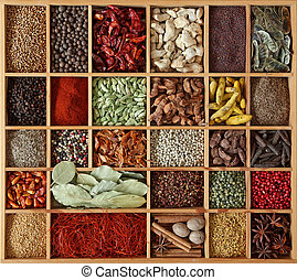 Spices in wooden box close up