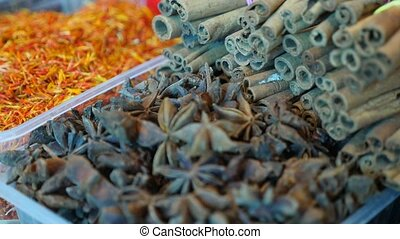 Spices, nuts, dried fruits on display at market on the...