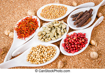 Spices on a white spoon.