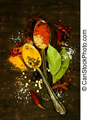 spices on a wooden board - Bright spices on an old wooden...