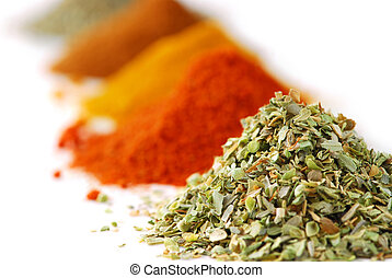 Spices - Heaps of various ground spices on white background
