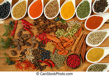 Spices. - Whole variety of colorful spices. Assortment of ...