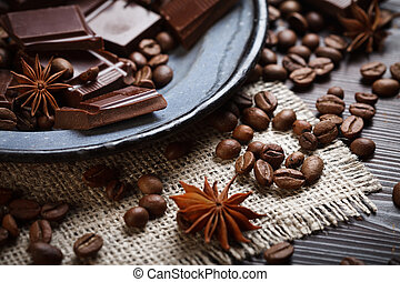 Spices with chocolate and coffee beans