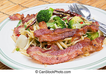 Spicy bacon spaghetti on the plate