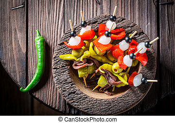 Spicy banderillas with peppers, olives and anchovies for spanish corrida