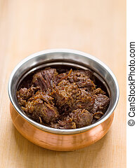 spicy beef rendang - close up of a bowl of spicy beef...