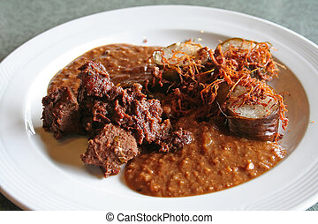 Spicy beef - Traditional malaysian dish of coconut rice and...