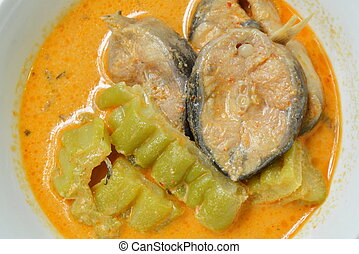 spicy boiled bitter cucumber with slice catfish in coconut milk and curry on bowl