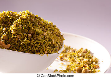 Badshahi Mix - Chiwda a variable mixture of spicy dried ingredients.