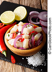 Spicy ceviche from cod with vegetable salsa close-up on a...