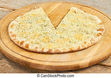 Spicy cheese pizza with removed slice.