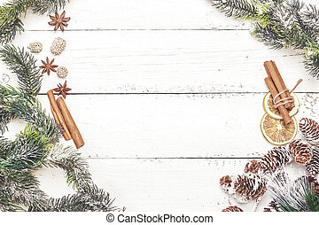 Spicy Christmas wood background with cinnamon sticks and anise stars. Top view. Copy space
