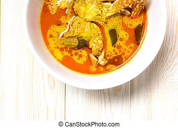 Spicy coconut milk soup with crab