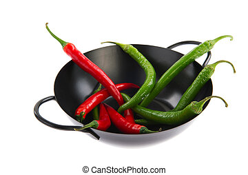 Spicy cooking - Black wok with green and red hot chili...