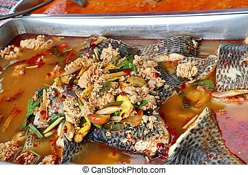 Spicy fish soup in market