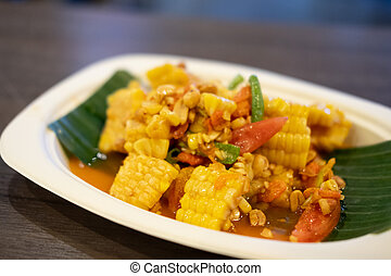 Spicy fruits salad mixed with corn and tomato