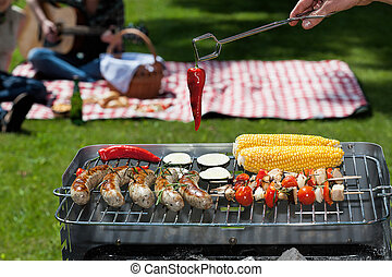 Spicy grill - A grill party with spicy vegetables and meat