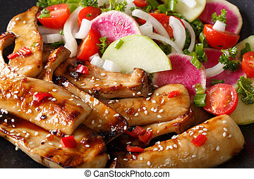 spicy king oyster mushrooms with chili and onions and fresh salad macro. horizontal