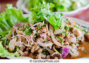 spicy minced pork  with mix vegetable on dish , Thai food