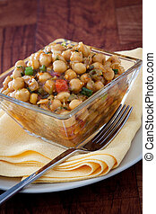 A flavorful delight - Moroccan style chickpeas salad infused with finely chopped vegetables. Topped with spicy dressing made with olive oil, herbs and select spices.