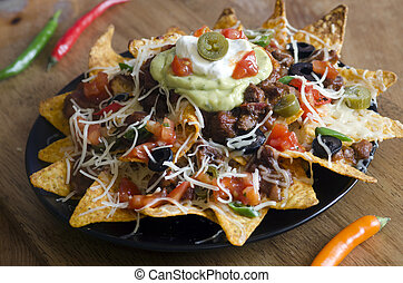 Nachos - Spicy Nachos with beef, chilli peppers, sour cream...
