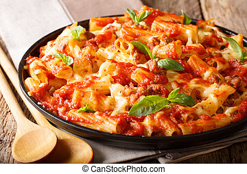 Spicy pasta ziti with minced meat, tomatoes, herbs and ...