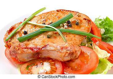 Spicy pork cutlet with fresh vegetables - Pork cutlet rubbed...