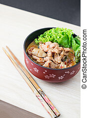 spicy pork noodle, thai style call tomyum