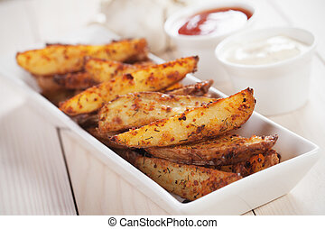 Spicy potato wedges - Spicy roasted potato wedges with salsa...