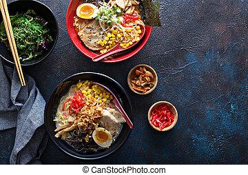 Spicy ramen bowls with noodles, pork and chicken - Spicy...