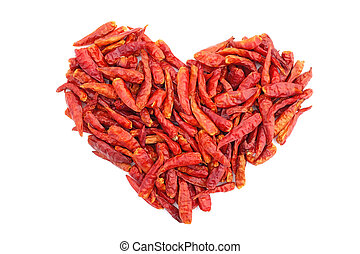 Spicy red birds eye chilli peppers in a heart shape