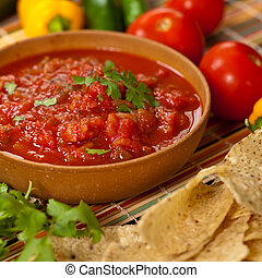 Spicy Red Salsa - Spicy red salsa with a plate of tortilla...